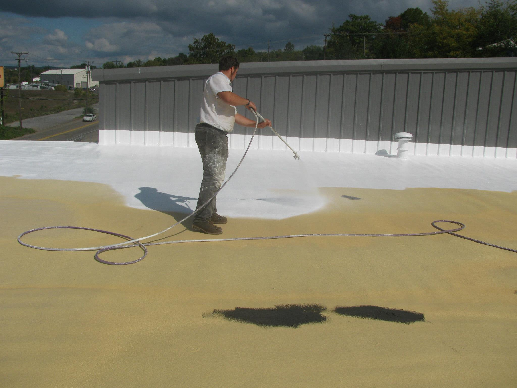 Spray foam roofing being applied.