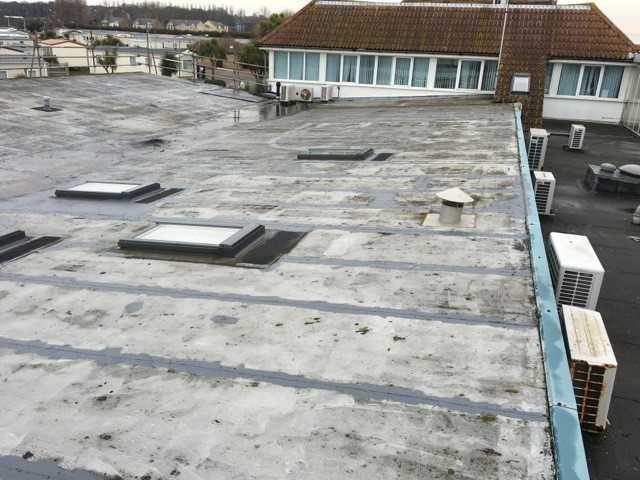 In this photo you can see the importance of commercial roof inspection.